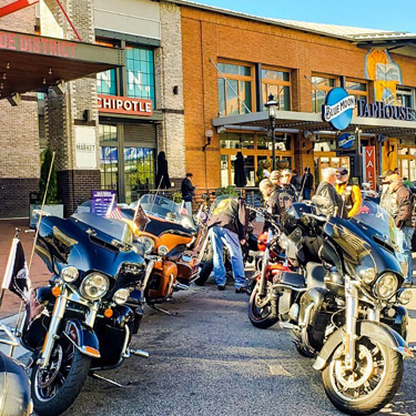 Rows of motorcycles outside of Blue Moon TapHouse